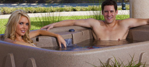Two people relaxing in a Dream Maker hot tub spa.
