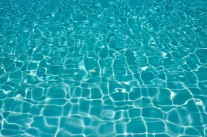 A close-up image of shimmering pool water.