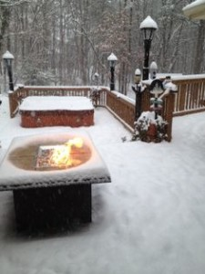 Outdoor GreatRoom Company Fire Pit on a Snowy Winter Deck