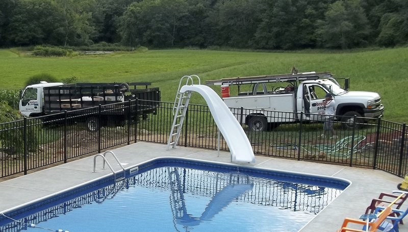 Brothers Pool with Installation Trucks