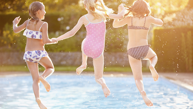 Young Girls Jumping in Pool